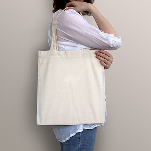 Girl is holding white canvas bag