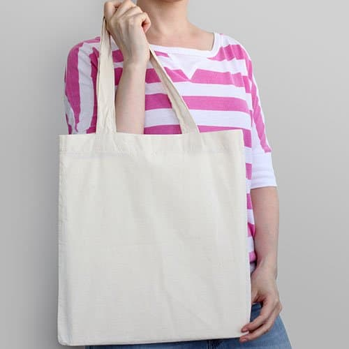 Girl is holding plain canvas tote bag